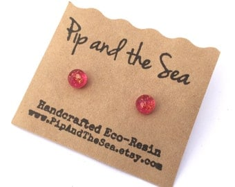 Delicate rose faceted eco-resin earrings with embedded flakes of copper coloured foil.