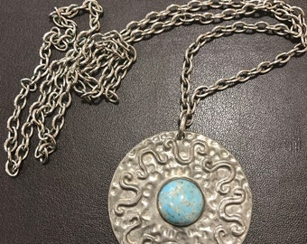 A vintage Ruskin style pewter pendant necklace with a Center turquoise glass cabochon