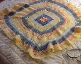 crocheted baby blanket in pastels