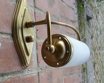 Vintage brass sconce/wall lamp brass with cylindirical glass bulb opaque