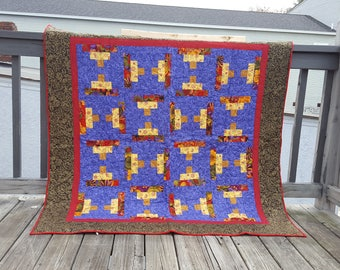 red purple gold and green throw