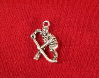 "BULK! 25pc ""hockey player"" charm in antique silver style (BC465B)"