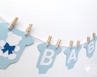Blue BABY Banner with teddy bear, baby bodysuit, romper shape. Party Bunting, Photo prop. Baby Shower Banner with text. Pastel blue white.
