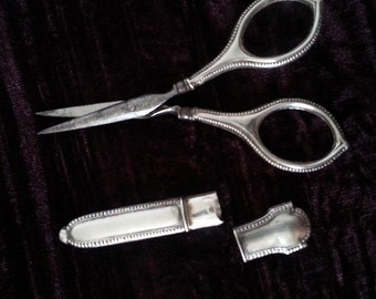 Vintage sewing accessories : scissors,needle case plus one more accessory