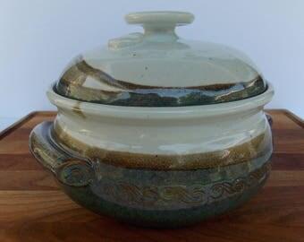 Handmade, ceramic, stoneware, Casserole Dish. Approx. 2 Qt. capacity. White with blue & tan trim.
