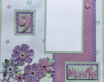 "Two 12""x 12"" pre-made scrapbook pages for your baby girl's 9 month pictures"
