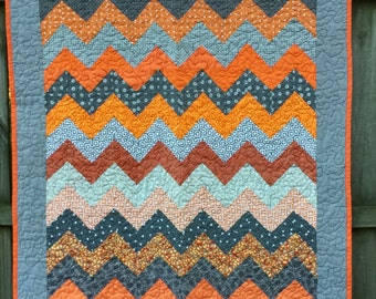 Quilt handmade patchwork triangles in vibrant orange and muted greys  chevronv design