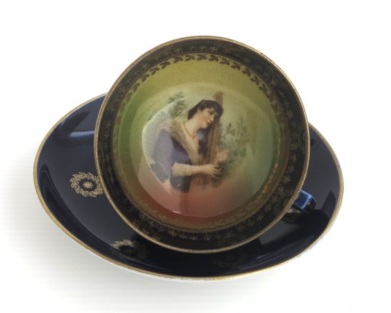 Vintage figural cup and saucer, cobalt blue, lots of gilt, hand painted portrait of woman playing harp inside cup, European, circa 1930s