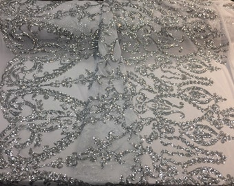 Silver royalty design embroider with Sequins on a 2 way stretch mesh -sold by yard