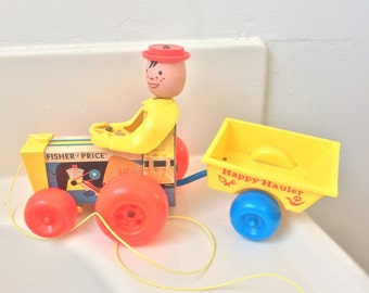 1967 Fisher Price farm tractor Happy Hauler pull toy