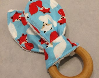 Eco friendly wood teething ring with blue fox print fabric