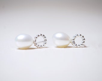 Silver plug earring with Pearl wire and freshwater pearl.