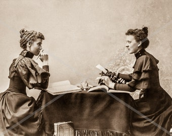 Fine Art Reproduction of an Antique Photo. Two Women with a Munson Typewriter.