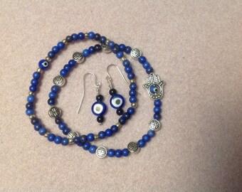 Blue Evil Eye bracelet and earring set.