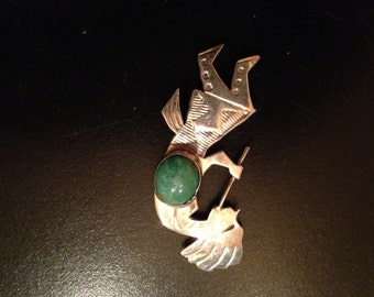 Sterling Silver Brooch/Pin of Kokopelli With Stone