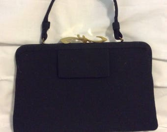 Vintage wool like black and gold clutch