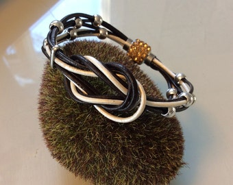 Leather love knot with silver balls bracelet