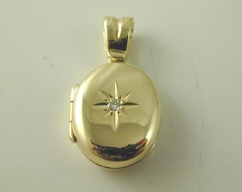 Gold locket set with diamond starburst design. 9 ct space for two pictures 4.7 g