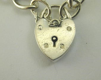 "Vintage silver charm bracelet with heart padlock. 7"" long. 14.5 grams."