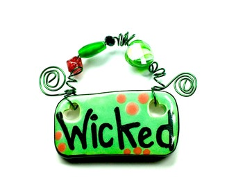 Wicked #565 green ceramic sign