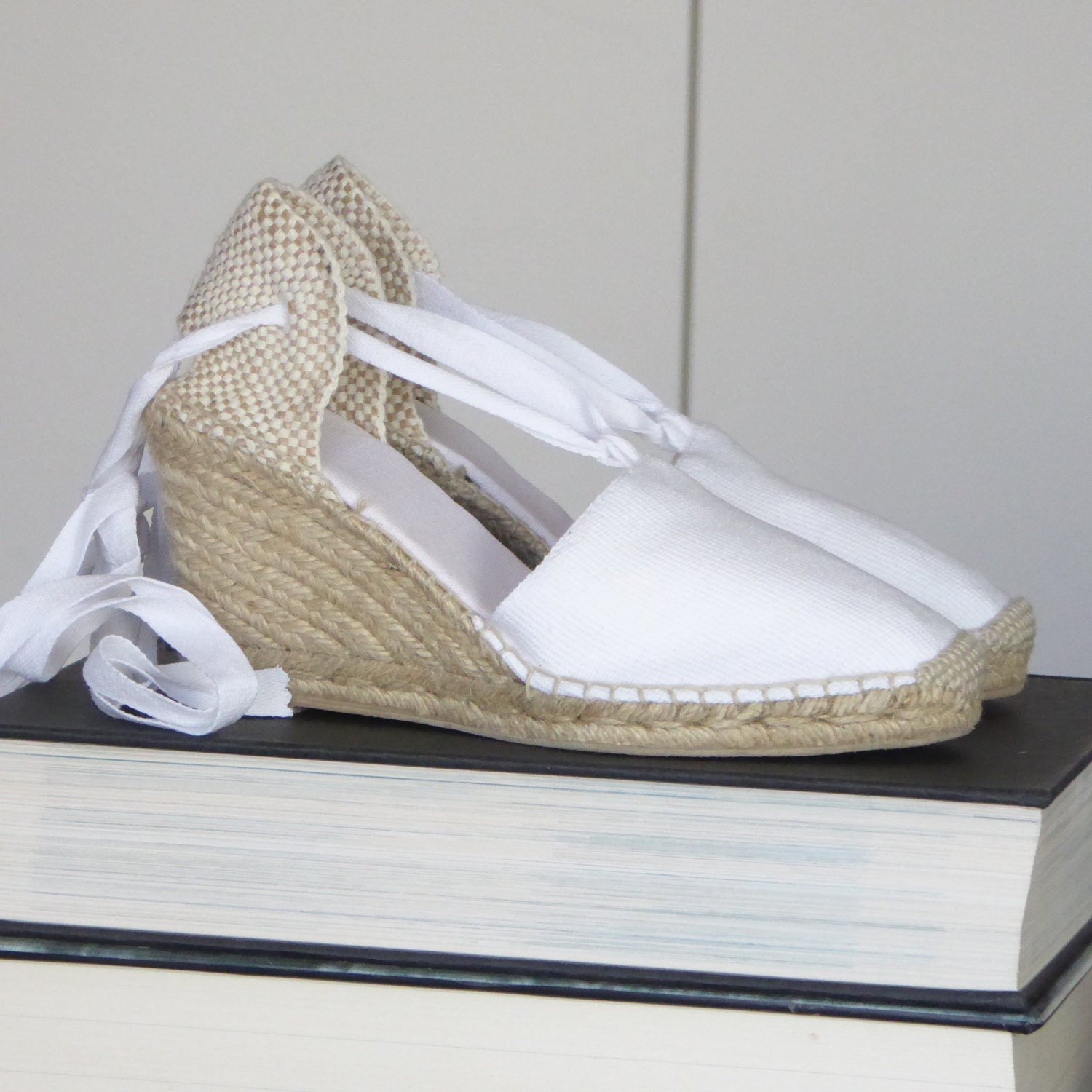 We guarantee you'll break hearts wearing our gorgeous Darcy Wedges! Wrap around the ankle or further up the leg with thick lace up fastening. Features a super summery cork heel with .