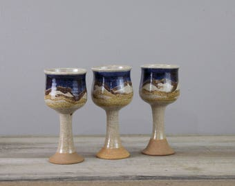 Vintage stoneware goblet with mountain design
