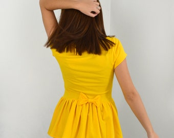 Yellow peplum top with bow/short sleeve peplum blouse.