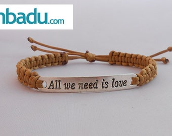 "Macrame bracelet metal plate message "" All you need is love"""