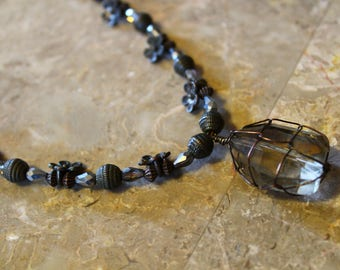 Glass and brass beaded necklace