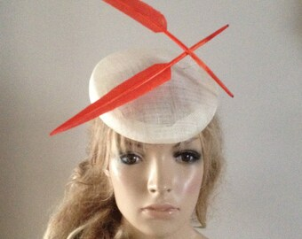 ivory perching hat adorned with a brace of 'floating'feathers.