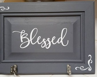 Coat hanger sign made from old cabinet door - Blessed