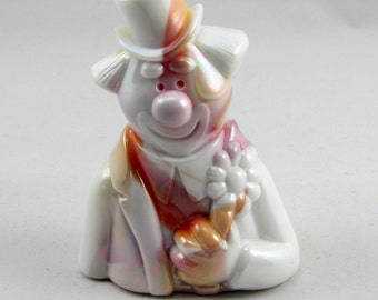 Beautiful Fenton Slag Glass Clown with Flower. The  Clown is a Pretty White Slag with swirls of Amber, Pink and Mauve throughout. RARE!