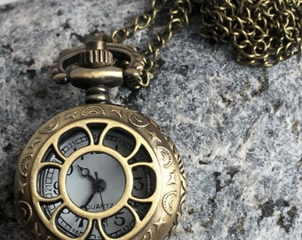 Alice in Wonderland Pocket Watch or Necklace watch in Steampunk Bronze effect. Never be late again!