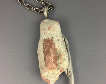 Revival,   Beach Stone and Found Metal Pendant by Deborah Smith