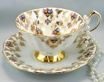 Vintage, Queen Anne Teacup & Saucer, Delicate Floral Gilded Pattern, Gold Rims, Bone English China made in 1960s.