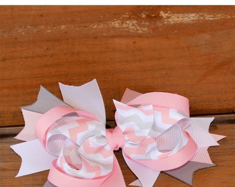 Pink and white chevronhair bow this beautiful hand made grosgrain Hair Bow is made from a pink ribbon on a white ribbon