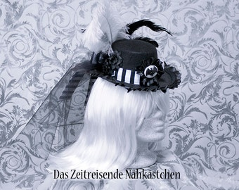 Victorian mini-hat, black and white stripes, decorated with bat cameo, tulle, feathers and flowers