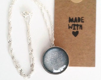 Icy blue glitter pendant necklace