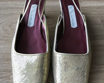 Gold Nina pumps size 8