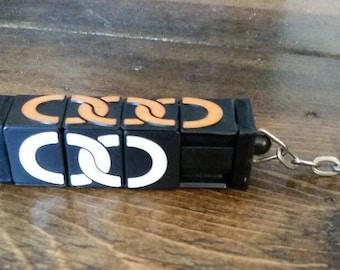 Siding puzzle keychain