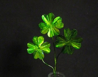 A hand crafted green tinted copper shamrock. Perfect for Irish people and those that want to be Irish