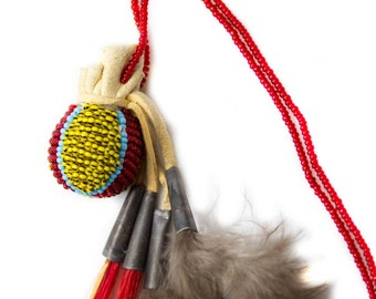 Indian medicine bundle from deerskin with beaded embroidered to the reassignment