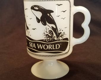 MUG SEA WORLD Footed Coffee White Milk Glass Shamu Dolphins San Diego Fire King Vintage Retro
