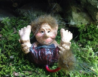 Fairy garden gnome rock troll rolling on the ground for miniature fairy garden