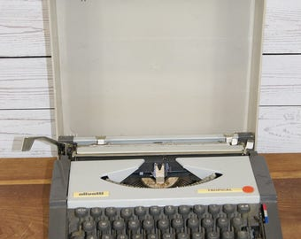 Vintage 1970s Portable Olivetti Tropical Manual Typewriter with Contiental Mid Century Styling in Original Plastic Case