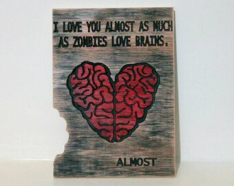 Valentines day zombie carving, wood carving Feast of Saint, brain horror love desire gore.
