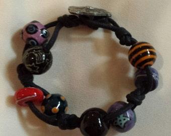 Whimsical Bead Bracelet on Leather Rope