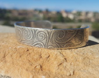 Oxidized, solid sterling silver cuff with swirls