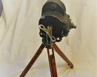 Vintage Oak Tri-Pod with a Vintage Bell & Howell Movie Camera