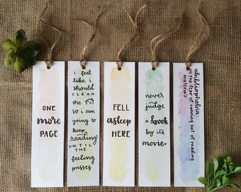 colorful watercolor bookmarks with twine hassle » funny calligraphy sayings » one more page » fell asleep here » never judge a book